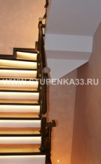 Лестница на металлическом каркасе с обшивкой лиственницы с подсветкой